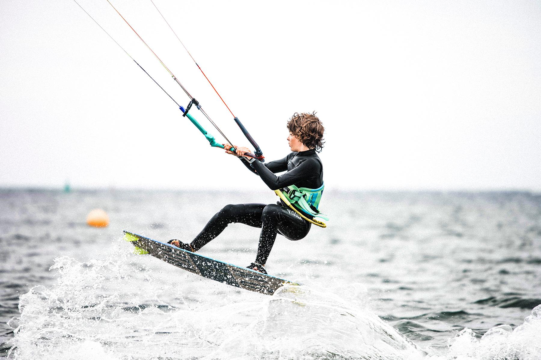 Boy kitesurfing